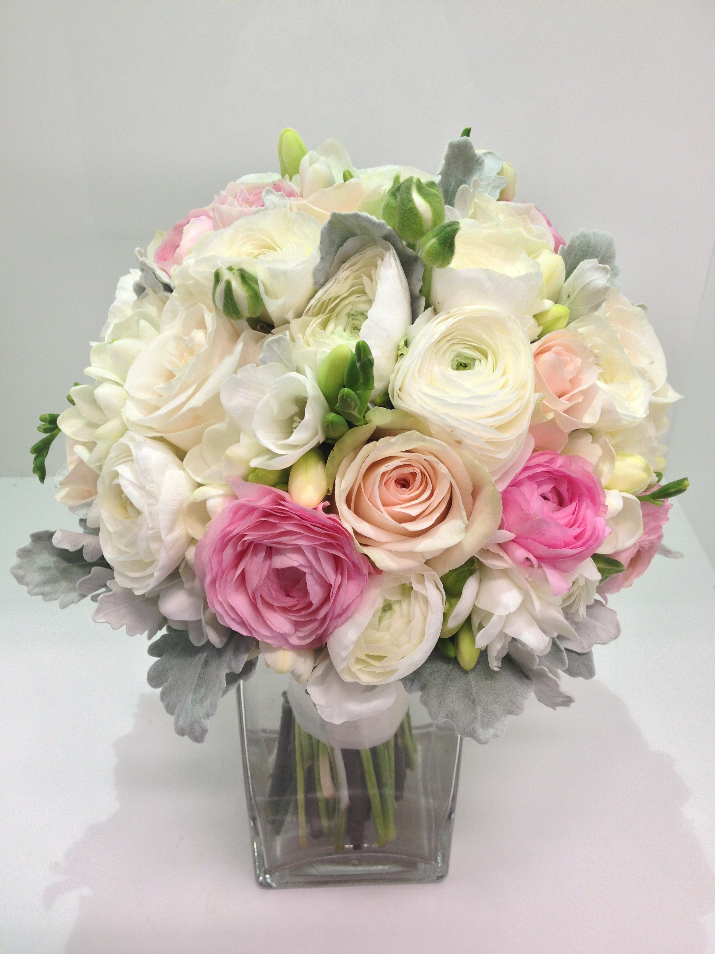 more on Ranuncula, freesia, rose and dusty miller posy in whites and pinks