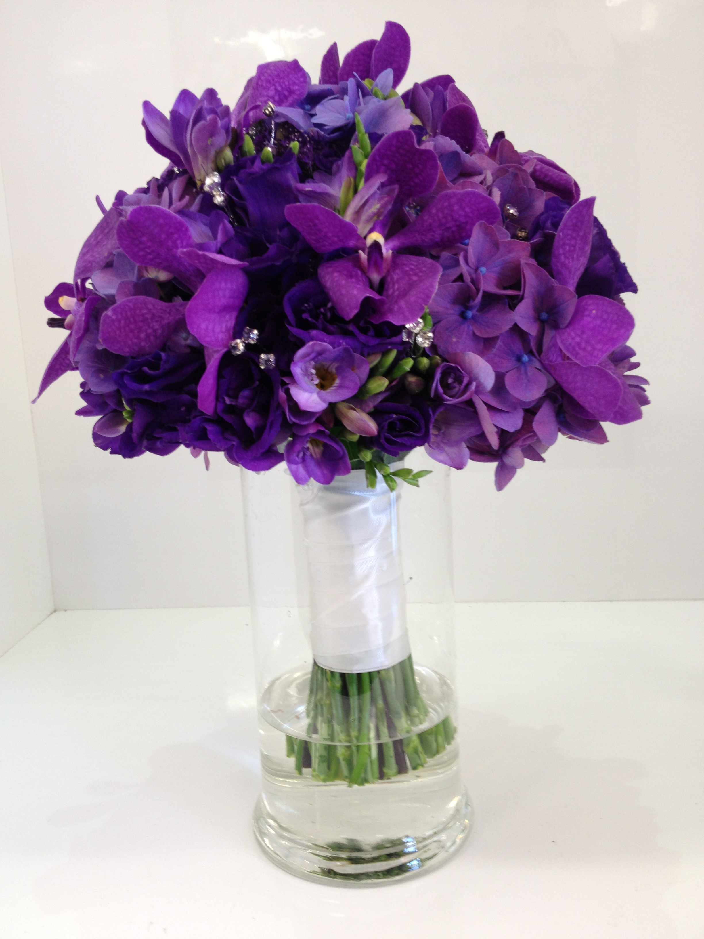 more on Purple orchids, lisianthus, roses, berries, dusty miller