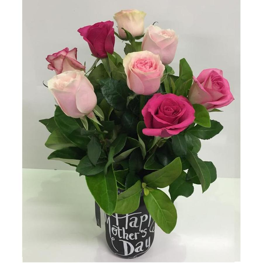 Black Board jar of pink roses - Image 1