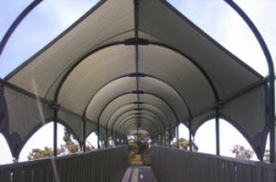Shade Sail over structure. Entrance to public swimming pool.