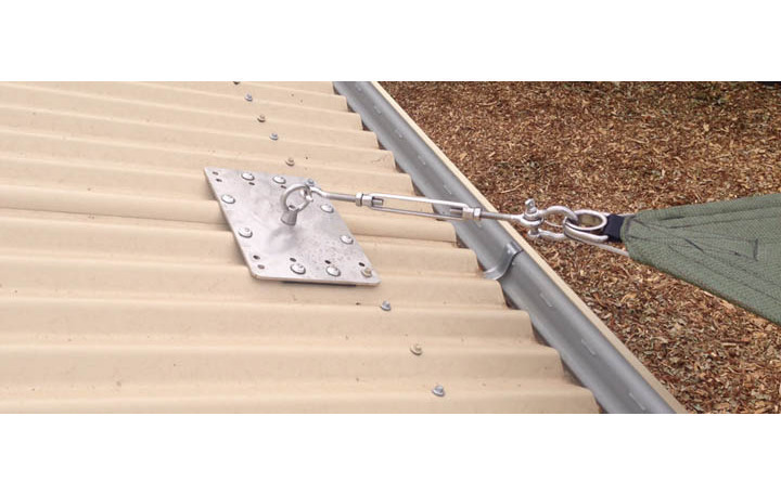 Photograph of Stainless steel roof plate used as sail fixing point on an iron roof.  All fittings are marine grade stainless steel.
