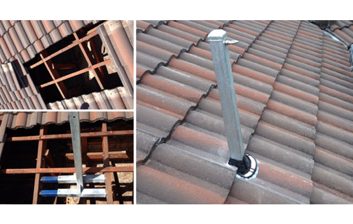 Photograph of Method of attaching roof mast to tile roof.